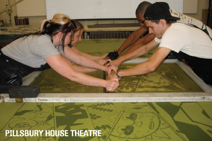 Natasha Pestich leads three interns in screen printing fabric to re-cover the couches.